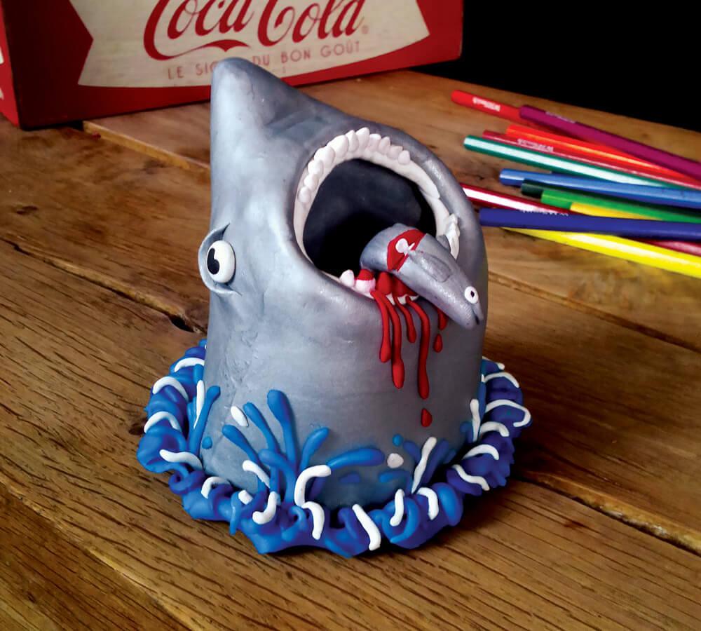 Polymer clay shark with half-eaten fish